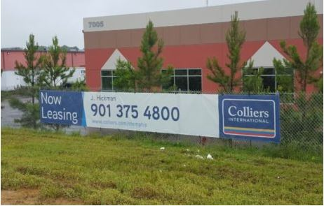 colliers now leasing mesh banner on fence