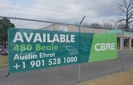 commercial real estate mesh banner on fence