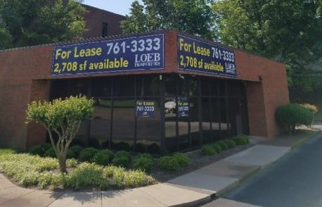 for lease banners mounted on brick building