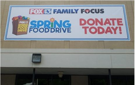 Fox 13 Food Drive Banner on Building Front